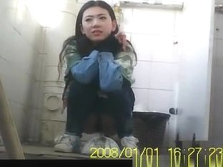 Asian girl pulls down her tight jeans to pee