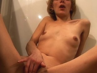 Video from AuntJudys: Blonde fingers her pussy in the kitchen