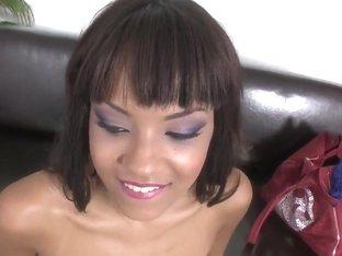 Sasha Jones kneeling and starting to suck