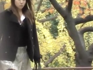 Lovely Japanese girl has her skirt lifted in public