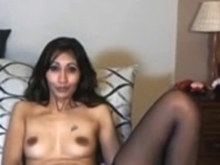 Indian beauty fucks a dildo on webcam