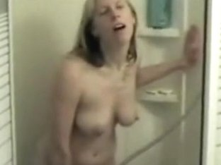 She masturbates with water jet and receives dripping orgasm