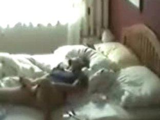 Hidden camera caught a naughty MILF masturbating in her bedroom