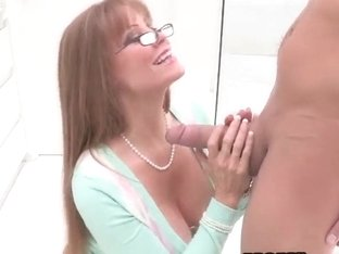 Busty mature Darla Crane gives man oral satisfaction