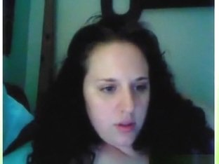 Chubby curly haired brunette girl plays with her huge boobs and rubs her shaved pussy on her bed o.