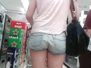 Teen with nice posterior in street candid voyeur clip