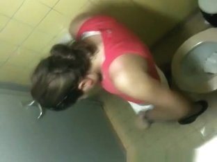 Woman in red top spied pissing