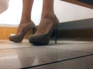 Woman in high heels pissing