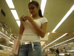 Teen girl in tight jeans buying food