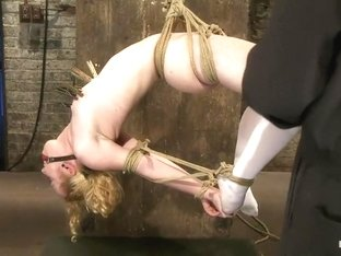 Sexy girl next door bound into a brutal back arch from hell.Made to cum like a common slut.