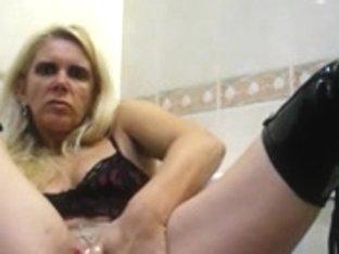 Pierced mature toying her ass