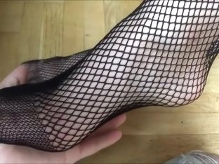 Mesmerized by stunning legs and feet in a fishnet
