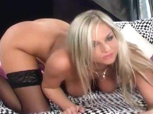 Busty blonde in a bra panties and black stockings