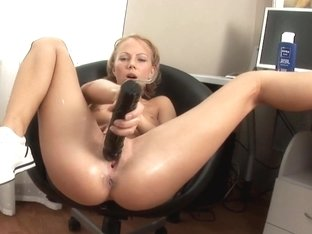 Gina Spreads Out In Her Chair To Fuck Dildo
