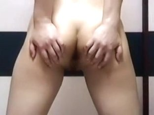 Oriental wife is undressing showing her diminutive breast and large unshaved bush