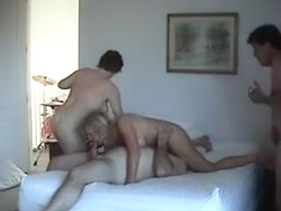 Two mature couples fucking together on the bed