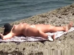 Shaved pussy nudist sunbathing