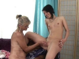 Blonde granny fucks a milf with a kinky dildo