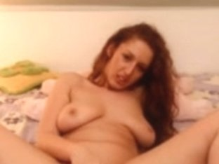 Chubby red head fingers pussy on bed