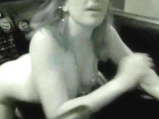 Wild busty babe fucks a gear shifter