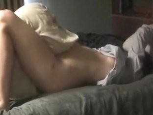 Nerdy girl with glasses rubs her pussy and rides her pillow