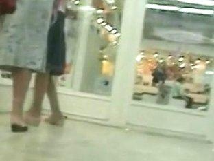 Upskirts public voyeur in a women's shoe store