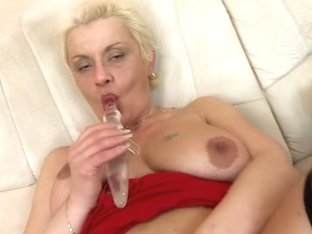 Nasty housewife playing with her glass marital-device