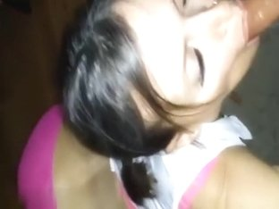 Dressed as a school girl and sucking his dick