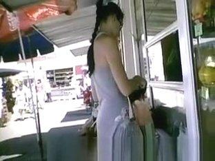 Upskirt on woman shopping