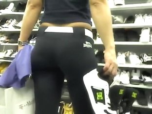 Bent over lady in the shoe store