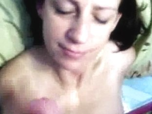 Brunette girl sucks cock and gets cum on her face
