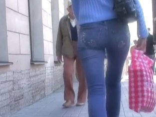 Appetizing ass in tight jeans in the street voyeur action