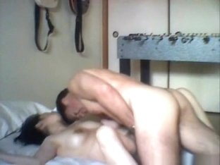 Asian milf with hairy pussy and big boobs fucks her husband in the bedroom