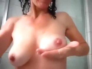My busty girlfriend enjoys showing off her big billibongs on camera