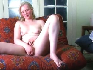 Chubby blonde plays with her hairy pussy on the sofa