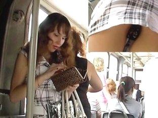 Brunette Hair babe in bus upskirt video