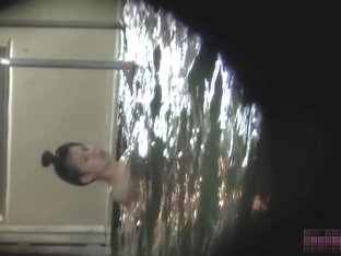 Asian girl standing in water and showing their tits su2664