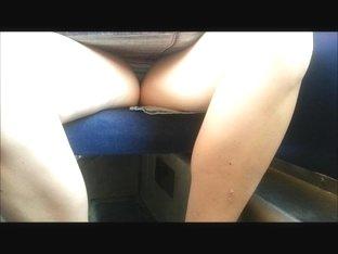 Upskirt in a train wide open legs