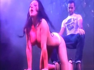 Live public strip show at erotic fair