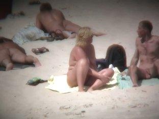 Beach cam shots of nude girls enjoying sand and sun