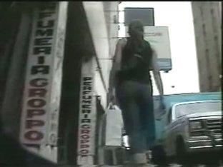 A superb derriere in a great upskirt thong video