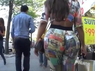 Big ass latin chick wearing tight colorful clothes