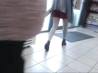 Thigh high socks, short skirt and heels