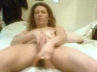 Mature woman toying herself