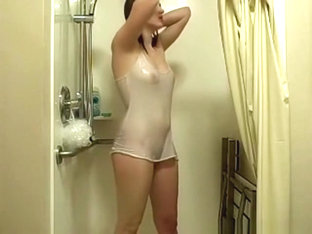 girl plays with her small tits and fingers her shaved pussy in the shower