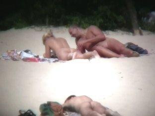Hot couple caught on a nude beach spy cam vid