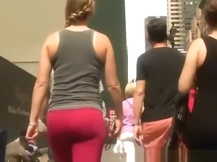 Ponytail girl in red leggings walking
