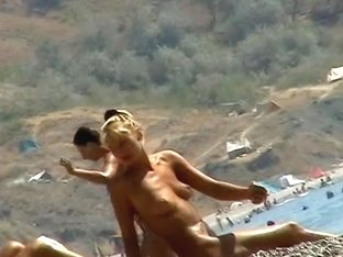 Sexy blond chicks sunbathing on a nude beach