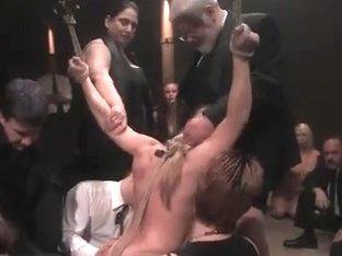 Busty blonde enjoys a kinky BDSM game with toys