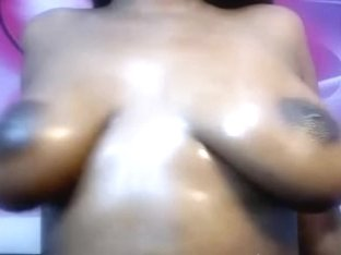 Big black girl with large areola fucks pussy with toy